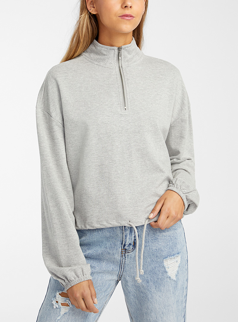 Le sweat demi-zip taille cordon