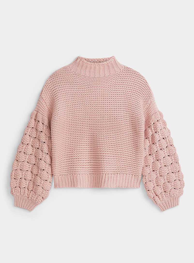 Le pull col montant manches pompons