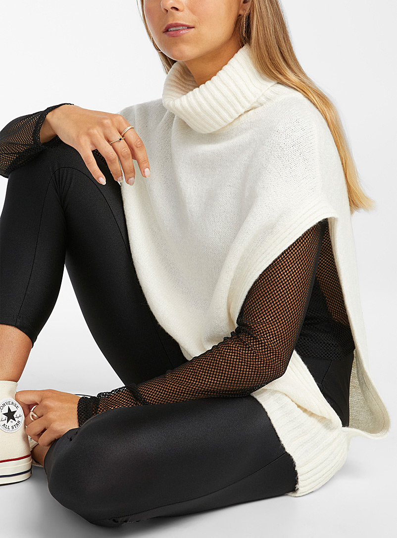 Twik Ivory White Sleeveless turtleneck sweater for women