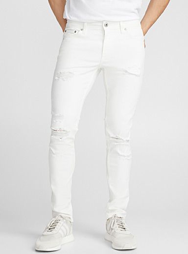 Distressed worn white jean <br>Super skinny fit