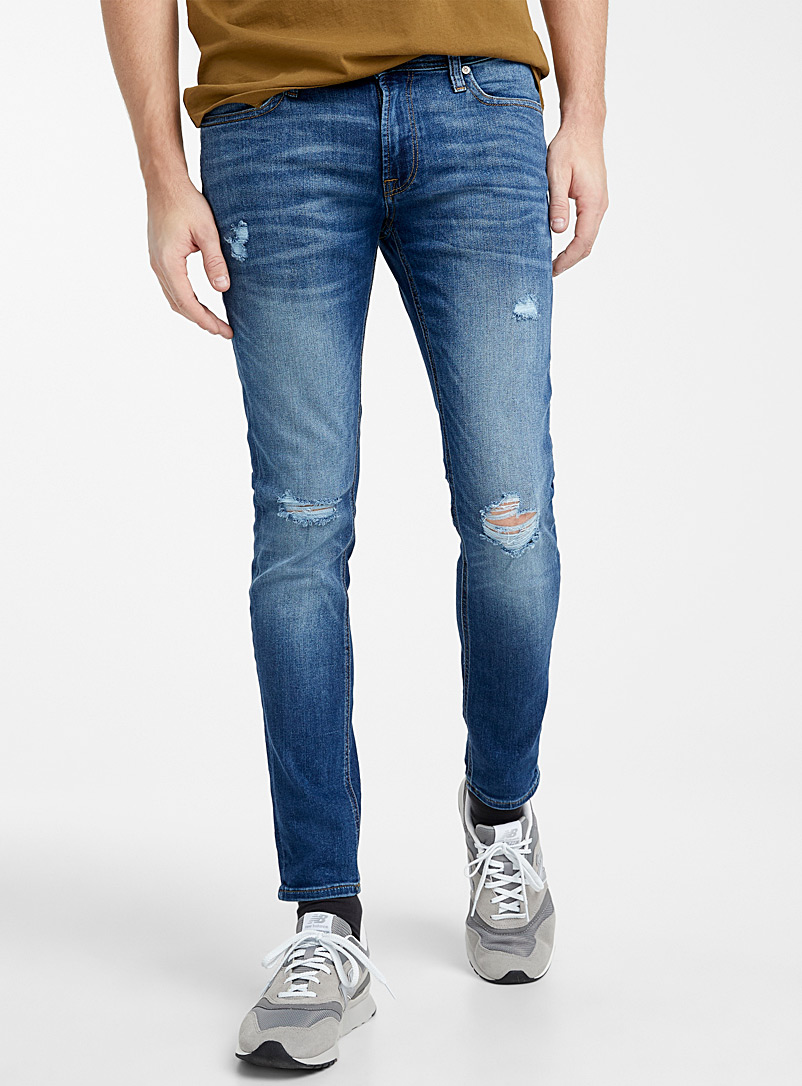 Ripped-knee blue jean  Super skinny fit