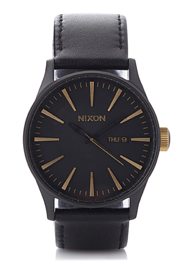 Black and gold Sentry watch