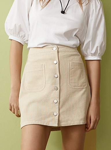 Twik Cream Beige Mirrored-button corduroy skirt for women