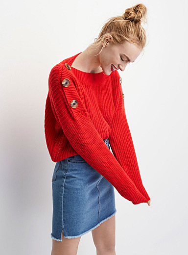 Le pull mégaboutons