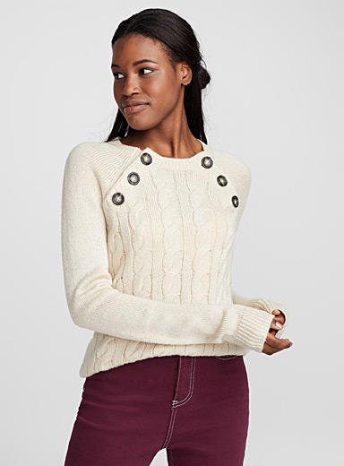 Le pull col boutons
