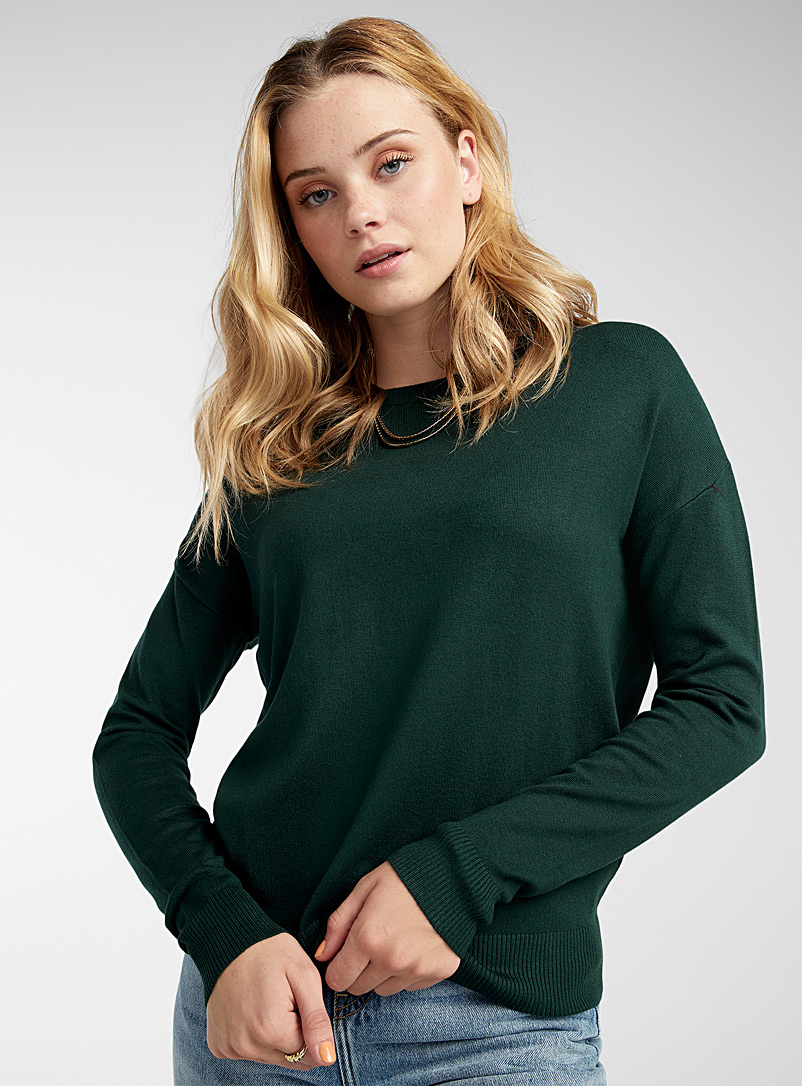 Le pull col rond tricot soyeux