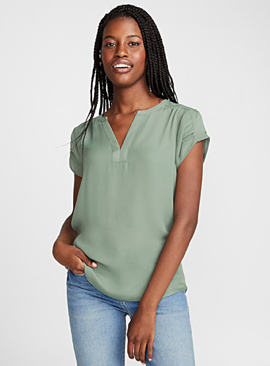 Solid mixed media V-neck blouse