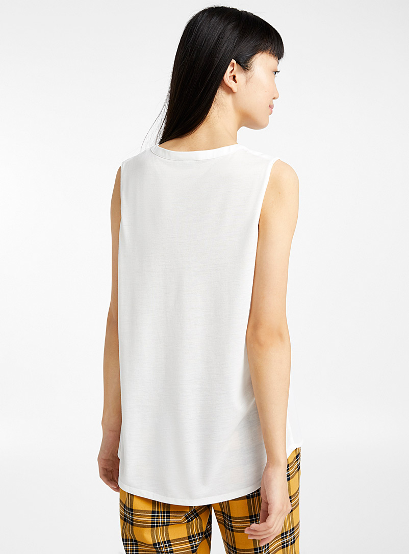 Twik White Recycled polyester sleeveless mixed media blouse for women