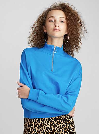 Le sweat col montant demi-zip