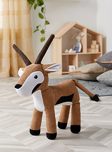 Frolicking antelope plush cushion