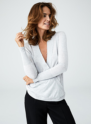 Fluid knit crossover sweater