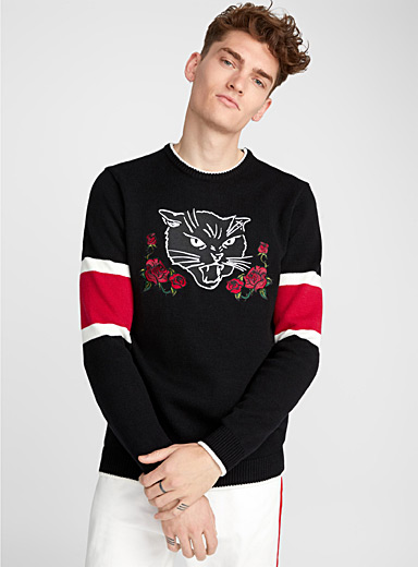 Le pull brodé manches rayées