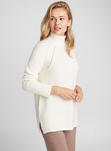 Le pull raglan col montant