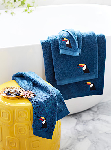 Embroidered toucan towels