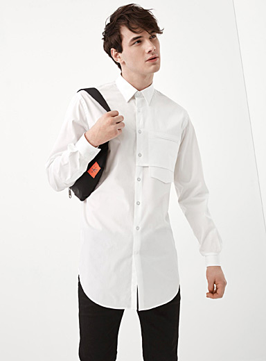 Storm flap pocket tunic shirt <br>Semi-tailored fit