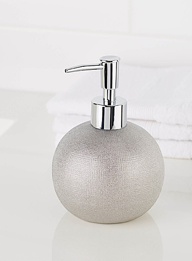 Round silver lotion dispenser