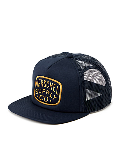 Gold logo trucker cap