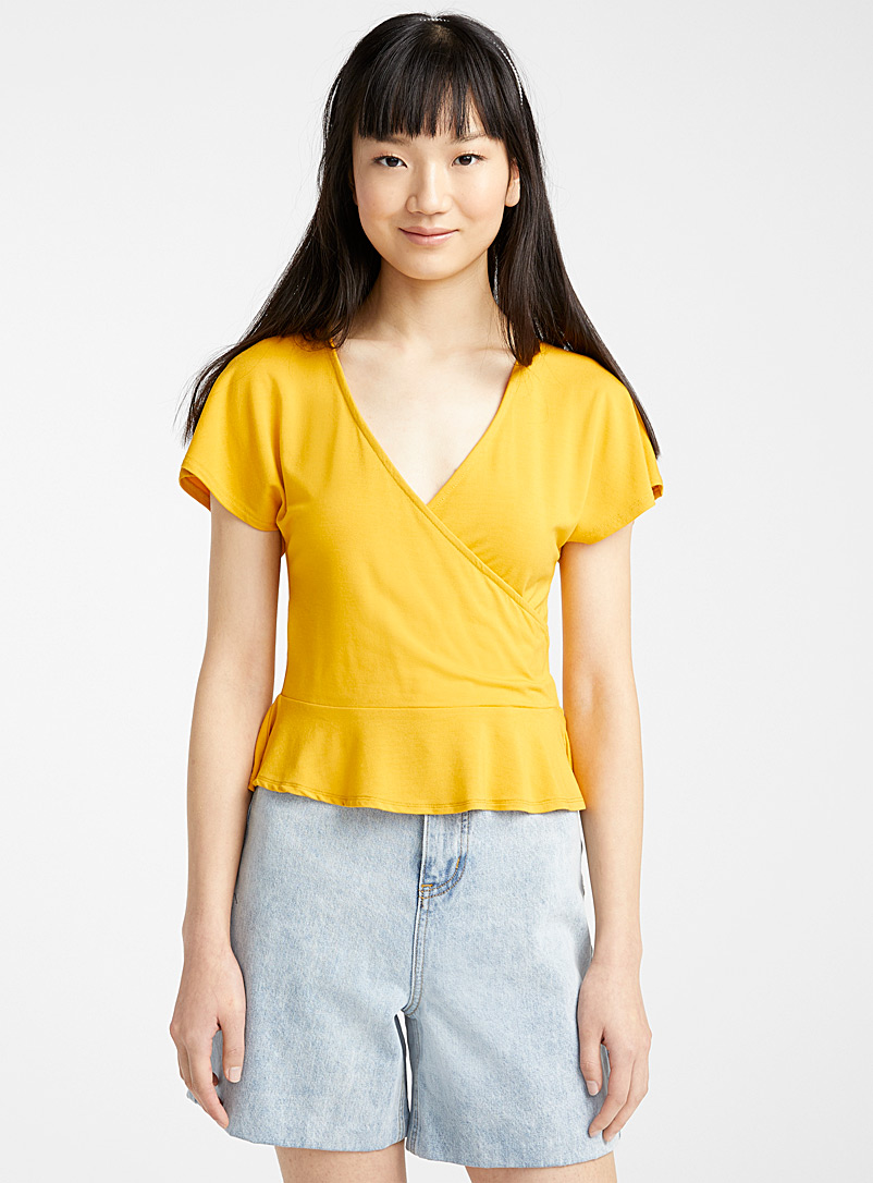 Twik Orange Peplum crossover tee for women