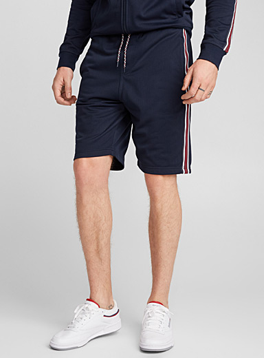 Perforated athletic jogger Bermudas