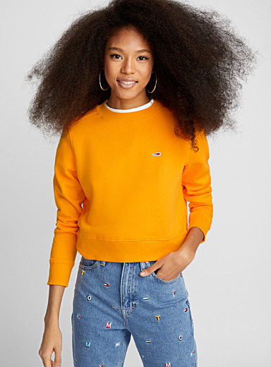 Le sweat jaune orange