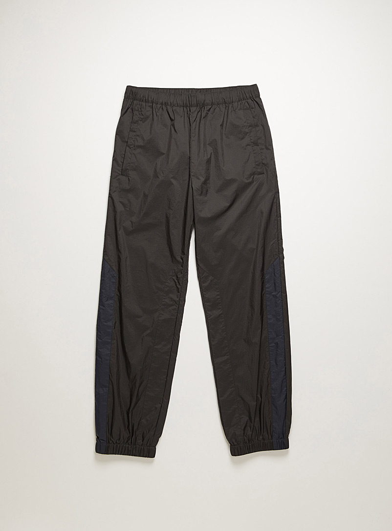 Acne Studios Black Ripstop track pants for men
