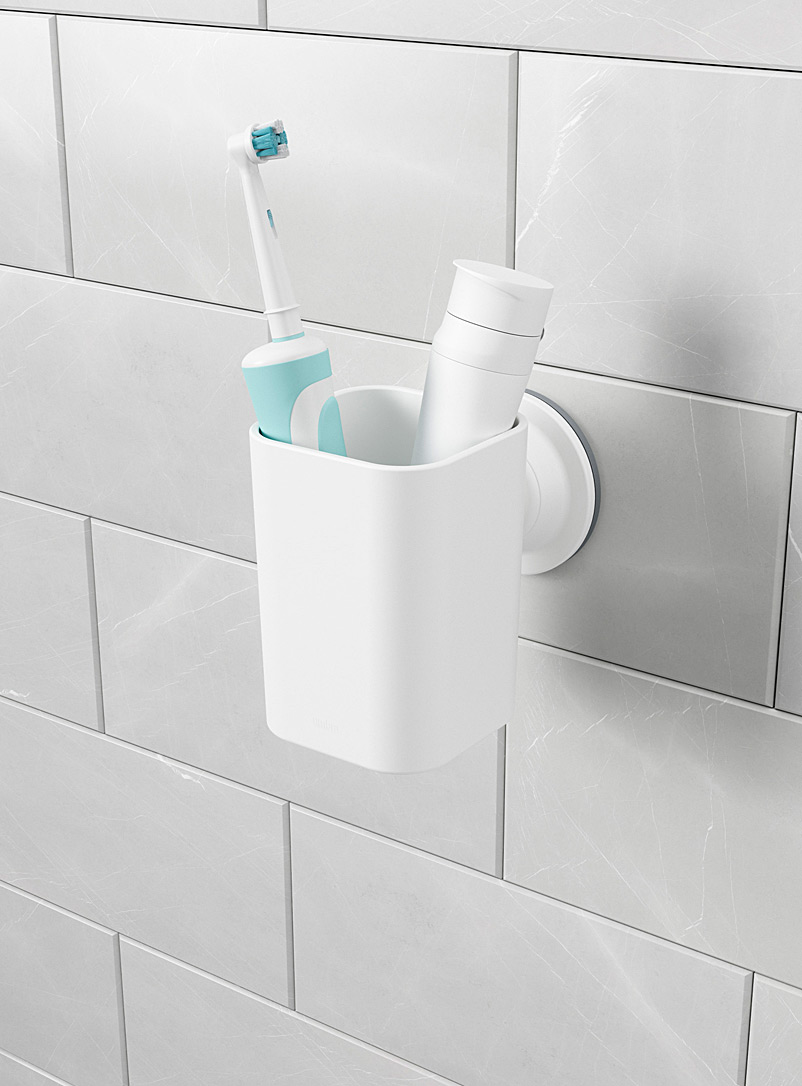 Flex toothbrush holder